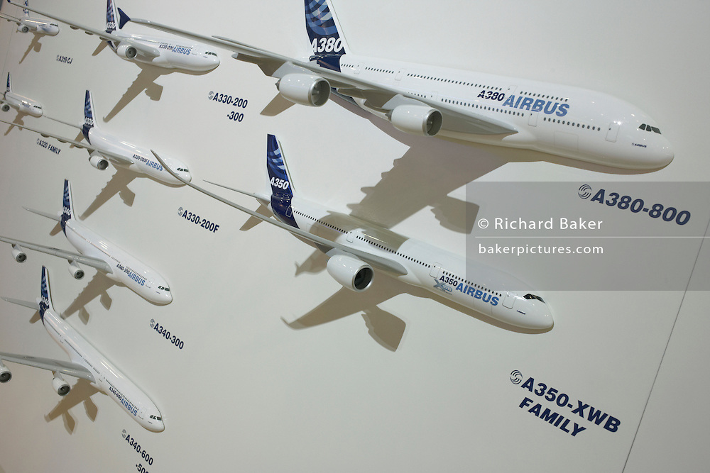 The Airbus family of jet airliners are mounted on a display board during the Paris Air Show exhibition at Le Bourget airfield