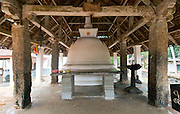 The stupa inside a building.<br /> The Dambadeniya Rajamaha Vihara