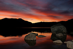 """Donner Lake Sunset 5"" - Photograph of rocks and an intense sunset on the South shore of Donner Lake in Truckee, California."