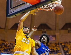 Jan 24, 2017; Morgantown, WV, USA; West Virginia Mountaineers forward Esa Ahmad (23) dunks during the second half against the Kansas Jayhawks at WVU Coliseum. Mandatory Credit: Ben Queen-USA TODAY Sports