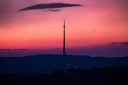 © Licensed to London News Pictures. 30/03/2016. Huddersfield UK. Picture shows the 1,084 ft Emley Moor transmitter in this morning's sunrise seen from Castle Hill in Huddersfield as weather forecast's predict a sunny day for the county of Yorkshire. Photo credit: Andrew McCaren/LNP