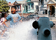 Hasain Rasheed/staff 6/09/02 Tribune News.Children beat Tuesday's heat at the corner of 15th and Campbell streets in Oakland by cooling off in a open fire hydrant.  Erica and Dan Wedding.March 3, 2007.Hasain Rasheed Photography 2007