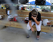 Taylor Kelley of the Texas Elite (Burleson, Texas) sits on the bench during the 2-1 loss in the ASA 12U National Championships at Green Valley Sports Complex in Moline on Thursday, August 2, 2012.