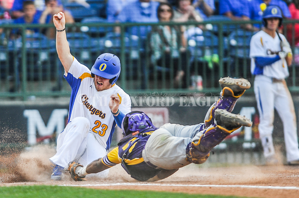 Oxford High's Thomas Dillard (23) avoids the tag from Hattiesburg catcher Devin Lang (28) to score in the MHSAA Class 5A championship series at Trustmark Park in Pearl, Miss. on Thursday, May 19, 2016. Oxford won 10-0 to win its second straight state title.