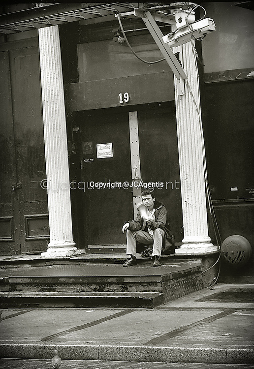 Street Photography of young man on Mercer Street in SoHo 1989. B&W Film  by Jacqueline C Agentis Limited Edition 1 of 25