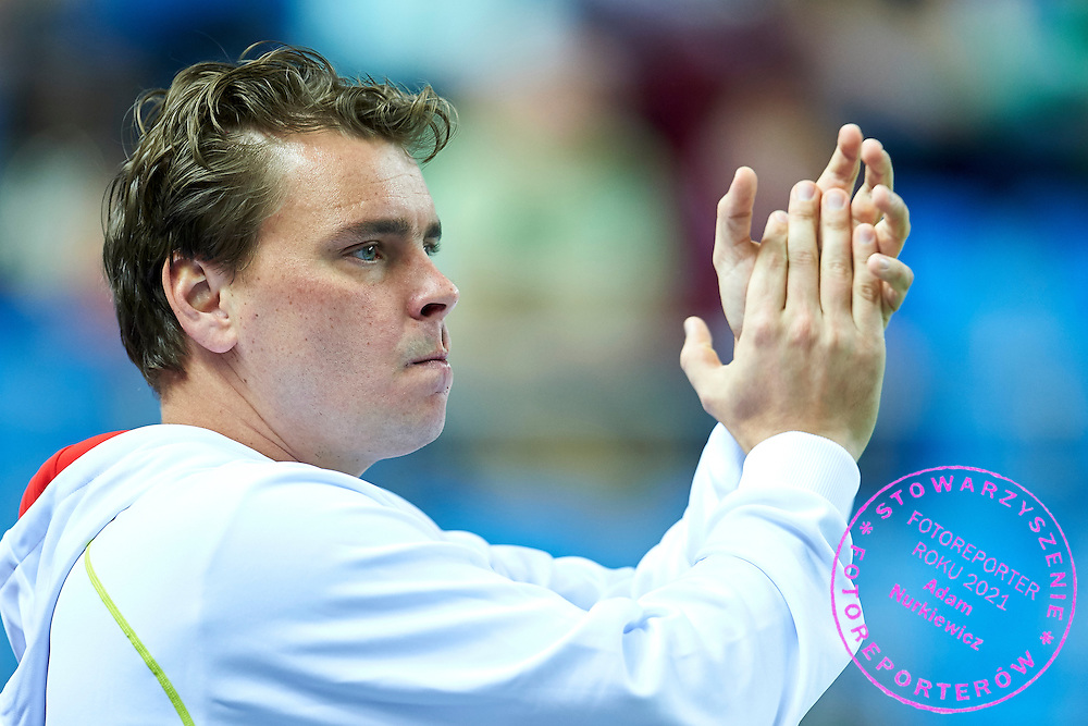 Marcin Matkowski of Poland supports his friend on the court during third day the Davies Cup / Group I Europe / Africa 1st round tennis match between Poland and Lithuania at Orlen Arena on March 8, 2015 in Plock, Poland<br /> Poland, Plock, March 8, 2015<br /> <br /> Picture also available in RAW (NEF) or TIFF format on special request.<br /> <br /> For editorial use only. Any commercial or promotional use requires permission.<br /> <br /> Mandatory credit:<br /> Photo by &copy; Adam Nurkiewicz / Mediasport