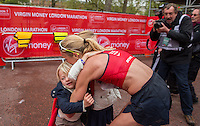 Paula Radcliffe with her children immediately after completing her last marathon in The Virgin Money London Marathon, Sunday 26th April 2015.<br /> <br /> Scott Heavey for Virgin Money London Marathon<br /> <br /> For more information please contact Penny Dain at pennyd@london-marathon.co.uk