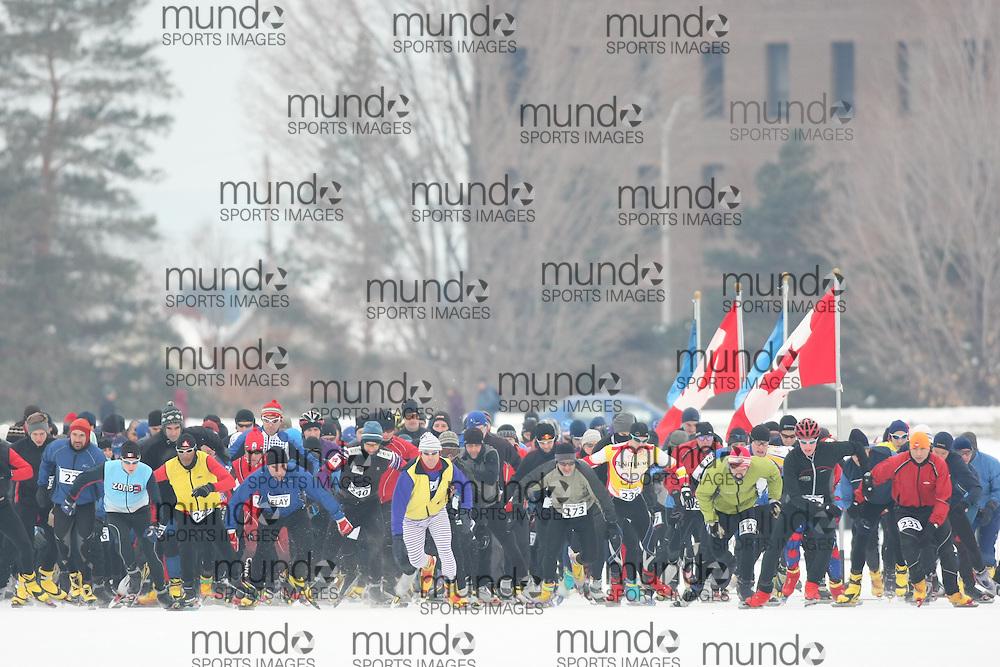 Ottawa, Canada ---07/02/09---Competitors at the start of the 2009 WinterludeTriathlon. It is a speed skate, cross country ski, run version of the triathlon. Photo copyright Sean Burges/Mundo Sport Images, 2009.