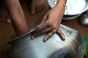 Tabasum Khatun, 14, is washing a metal pot in the courtyard of her home in Algunda village, pop. 1000, Giridih District, rural Jharkhand, India.