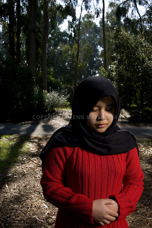 Stanford students, Atiqah Zailani (Muslim) among trees near Palm Drive.