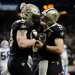 Jan 7, 2018; New Orleans, LA, USA; New Orleans Saints tight end Josh Hill (89) is congratulated by quarterback Drew Brees (9) after catching a touchdown pass against the Carolina Panthers during the second quarter in the NFC Wild Card playoff football game at Mercedes-Benz Superdome. Mandatory Credit: Derick E. Hingle-USA TODAY Sports