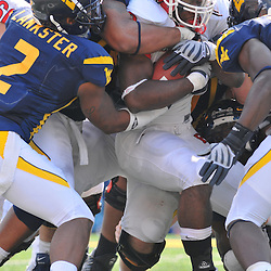 Oct 4, 2008; Morgantown, West Virginia, United States; Rutgers running back Jourdan Brooks is gang tackled by the West Virginia defense during the fourth quarter of West Virginia's 24-17 victory at Milan Puskar Stadium.