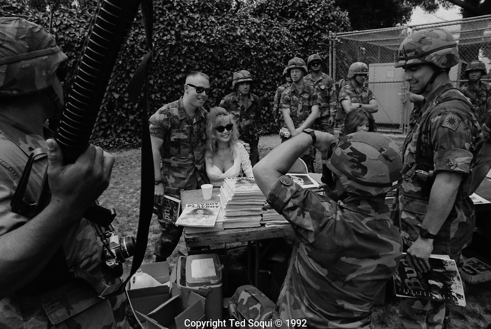 Playboy Playmate Suzi Simpson visit the California National Guard who are camped at the grounds of the LA Coliseum.