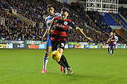 Queens Park Rangers defender Grant Hall protects the ball from Reading's Nick Blackman during the Sky Bet Championship match between Reading and Queens Park Rangers at the Madejski Stadium, Reading, England on 3 December 2015. Photo by Mark Davies.