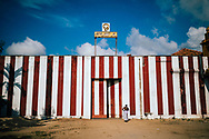 A priest walks toward the Nallur Kandaswamy temple, one of Jaffna's most sacred Hindu sites, Jaffna, Sri Lanka, Asia