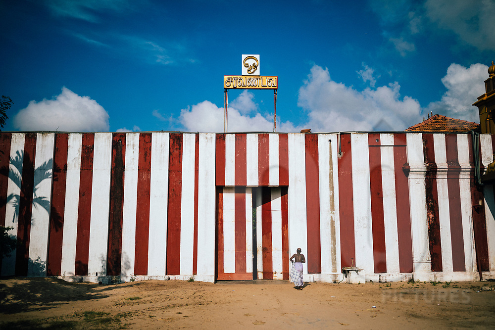A priest walks toward the Nallur Kandaswamy temple, one of Jaffna's most sacred Hindu sites, Jaffna, Sri Lanka, Asia