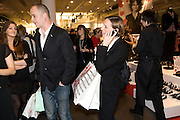 DINOS CHAPMAN; SERAPHINE CHAPMAN, H & M preview of Come Des Garcons for H & M. H & M Regent St. London W1. 12 November 2008.  *** Local Caption *** -DO NOT ARCHIVE-© Copyright Photograph by Dafydd Jones. 248 Clapham Rd. London SW9 0PZ. Tel 0207 820 0771. www.dafjones.com.