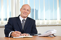 Portrait of businessman working at office