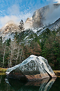 The granite monolith of Half Dome (8836 feet or 2693 meters elevation) rises above Mirror Lake, Yosemite National Park, Sierra Nevada, California, USA. The peak rises 4737 ft (1444 m) above the valley floor. Designated a World Heritage Site by UNESCO in 1984, Yosemite is internationally recognized for its spectacular granite cliffs, waterfalls, clear streams, Giant Sequoia groves, and biological diversity. 100 million years ago, the Sierra Nevada crystallized into granite from magma 5 miles underground. The range started uplifting 4 million years ago, and glaciers eroded the landscape seen today in Yosemite. Panorama stitched from 6 overlapping photos.