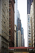 Rows of buildings along a downtown Chicago Street.