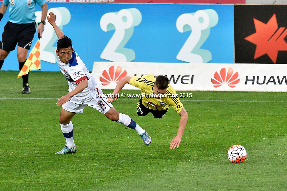 Kjie Lee (L) of the Jets fights for possession with Louis Fenton of the Phoenix during the A-League - Wellington Phoenix v Jets football match at Westpac Stadium in Wellington on Sunday the 11th of October 2015. Copyright Photo by Marty Melville / www.Photosport.nz