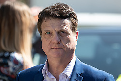 "© Licensed to London News Pictures . 06/05/2018. London, UK. UKIP leader GERARD BATTEN at the demonstration outside Downing Street on Whitehall . Supporters of alt-right and anti-Islam groups, including Generation Identity and the Democratic Football Lads Alliance, demonstrate at Whitehall in Westminster, opposed by anti-fascists. Speakers billed in the ""Day for Freedom"" include former EDL leader Tommy Robinson, Milo Yiannopoulos, youtuber Count Dankula (Markus Meechan), For Britain leader Anne Marie Waters, UKIP leader Gerard Batten, Breitbart's Raheem Kassam and Lauren Southern. The event was originally planned as a march to Twitter's HQ in protest at their banning of Robinson and the Home Office's ban on Martin Sellner and Brittany Pettibone entering the UK, in what protesters describe as limits being imposed on free speech. Photo credit: Joel Goodman/LNP"