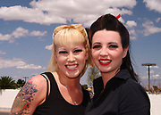 A portrait of two young smiling girls, 50's style, Viva Las Vegas Festival, Las Vegas, USA 2006.