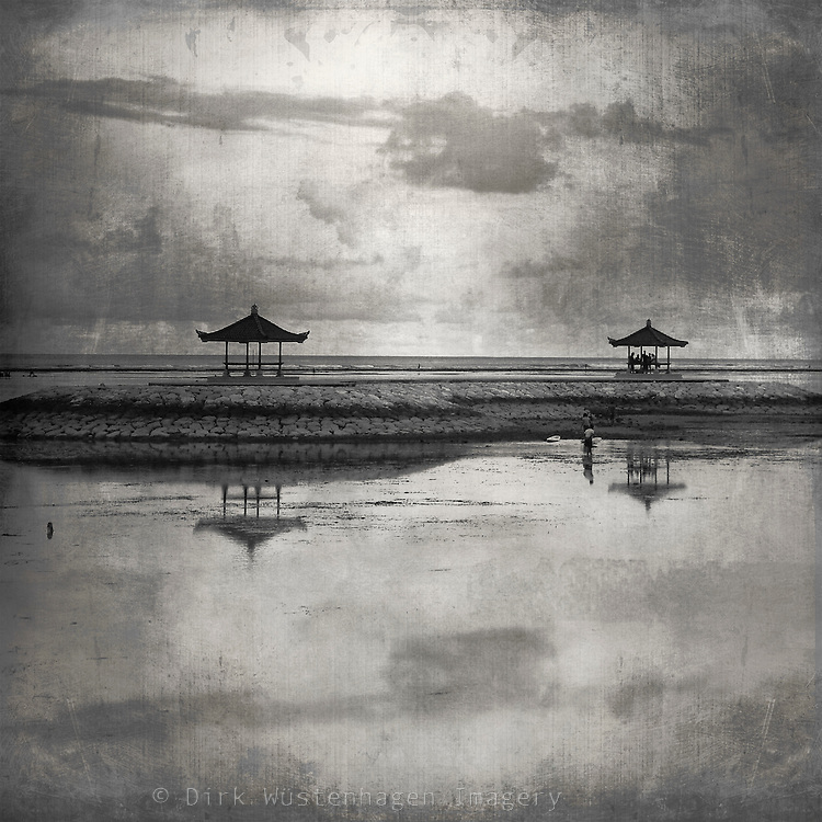 Monochrome photograph of a serene scene at the beach of Sanur, Bal, Indonesia.
