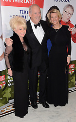 Barbara Windsor, Gyles Brandreth and Gillian Taylforth attend The Care After Combat Inaugural Ball at The Dorchester Hotel, Park Lane, London on the Tuesday 31st March 2015