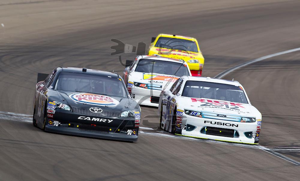 LAS VEGAS, NV - MAR 11, 2012:  Travis Kavapil (93) and David Ragan (34) battle for position during the Kobalt Tools 400 race at the Las Vegas Motor Speedway in Las Vegas, NV.