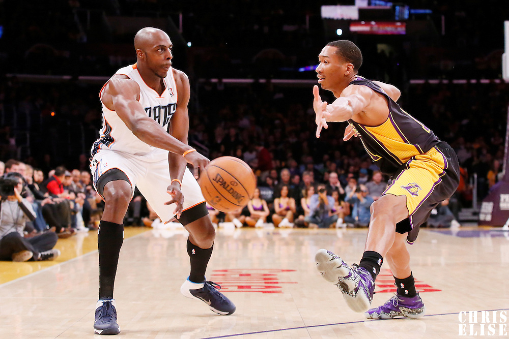 31 January 2014: Charlotte Bobcats power forward Anthony Tolliver (43) passes the ball past Los Angeles Lakers small forward Wesley Johnson (11) during the Charlotte Bobcats 110-100 victory over the Los Angeles Lakers at the Staples Center, Los Angeles, California, USA.