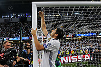 Alvaro Morata of Real Madrid cuts the net to take a souvenir during the UEFA Champions League Final match between Real Madrid and Juventus at the National Stadium of Wales, Cardiff, Wales on 3 June 2017. Photo by Giuseppe Maffia.<br /> <br /> Giuseppe Maffia/UK Sports Pics Ltd/Alterphotos