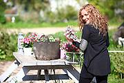 Woman works in her garden