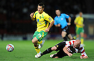 Doncaster - Tuesday September 14th, 2010:  Norwich City's Wesley Hoolahan and Doncaster Rovers's James O'Connor in action during the NPower Championship match at Keepmoat Stadium, Doncaster. (Pic by Dave Howarth/Focus Images)