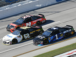 October 14, 2018 - Talladega, AL, U.S. - TALLADEGA, AL - OCTOBER 14: Jamie McMurray, Chip Ganassi Racing, Chevrolet Camaro Cessna (1), Brendan Gaughan, Beard Motorsports, Chevrolet Camaro Beard Oil Distributing / South Point Hotel & Casino (62) and Erik Jones, Joe Gibbs Racing, Toyota Camry Craftsman (20) race three wide during the 1000Bulbs.com 500 on October 14, 2018, at Talladega Superspeedway in Tallageda, AL.(Photo by Jeffrey Vest/Icon Sportswire) (Credit Image: © Jeffrey Vest/Icon SMI via ZUMA Press)