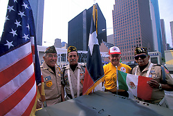 Stock photo of four men celebrating during the Veterans Day Parade in downtown Houston Texas