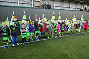 Flag bearers during the EFL Sky Bet League 2 match between Forest Green Rovers and Morecambe at the New Lawn, Forest Green, United Kingdom on 17 November 2018.