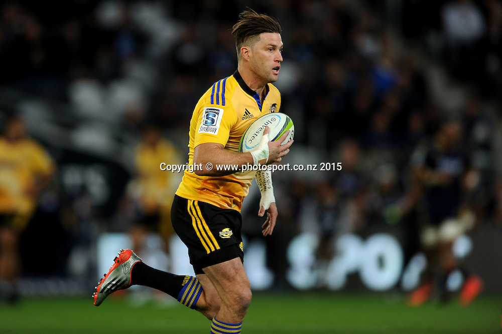 Cory Jane of the Hurricanes makes a break, during the Super Rugby Match between the Highlanders and the Hurricanes, at Forsyth Barr Stadium, Dunedin, New Zealand, 20 March 2015. Credit: Joe Allison / www.photosport.co.nz