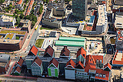 Nederland, Noord-Holland, Zaanstad, 14-06-2012; Inverdan, nieuwe stadscentrum Zaandam, masterplan Sjoerd Soeters. Station in de voorgrond. Het Zaanse huisjeshotel - Inntel Hotel - is een ontwerp Wilfried van Winden..New  center of the city of Zaandam, developed according to the master plan by architect Sjoerd Soeters. Train station in the foreground. The hotel built in a postmodern version of the style of the historic houses of Zaandam- Inntel Hotel - was designed by Wilfried van Winden..luchtfoto (toeslag), aerial photo (additional fee required).foto/photo Siebe Swart