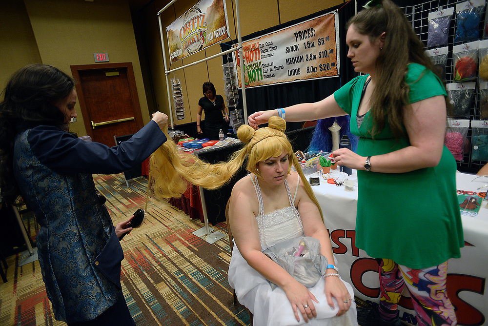 apl051417c/ASECTION/pierre-louis/JOURNAL 051417<br /> Hanna Webley,, center is outfitted with a &quot;Princess Serenity &quot; wig by Just Cos ! owner Bek Miller,, left sand Kaitlin Brunson,, while attending the Duke City Comic Con  .Photographed on Sunday May 14 2017. .Adolphe Pierre-Louis/JOURNAL