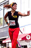 Middletown, New York - An instructor from Studio Ayo leads Zumba in the Street during the 2012 Run 4 Downtown road race on Saturday, Aug. 18, 2012.