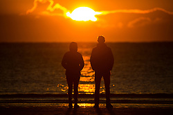 © Licensed to London News Pictures. 02/11/2018. Scarborough UK. People watch the sunrise in Scarborough this morning on a cold but bright start to the day on the Yorkshire coast. Photo credit: Andrew McCaren/LNP