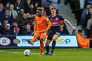 Luton Town forward Kazenga LuaLua (25) holds off Doncaster Rovers defender Paul Downing (31) during the EFL Sky Bet League 1 match between Luton Town and Doncaster Rovers at Kenilworth Road, Luton, England on 23 March 2019.
