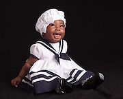Portrait of 6 month old baby girl by Bill Shaw at Art of Photography Studio.