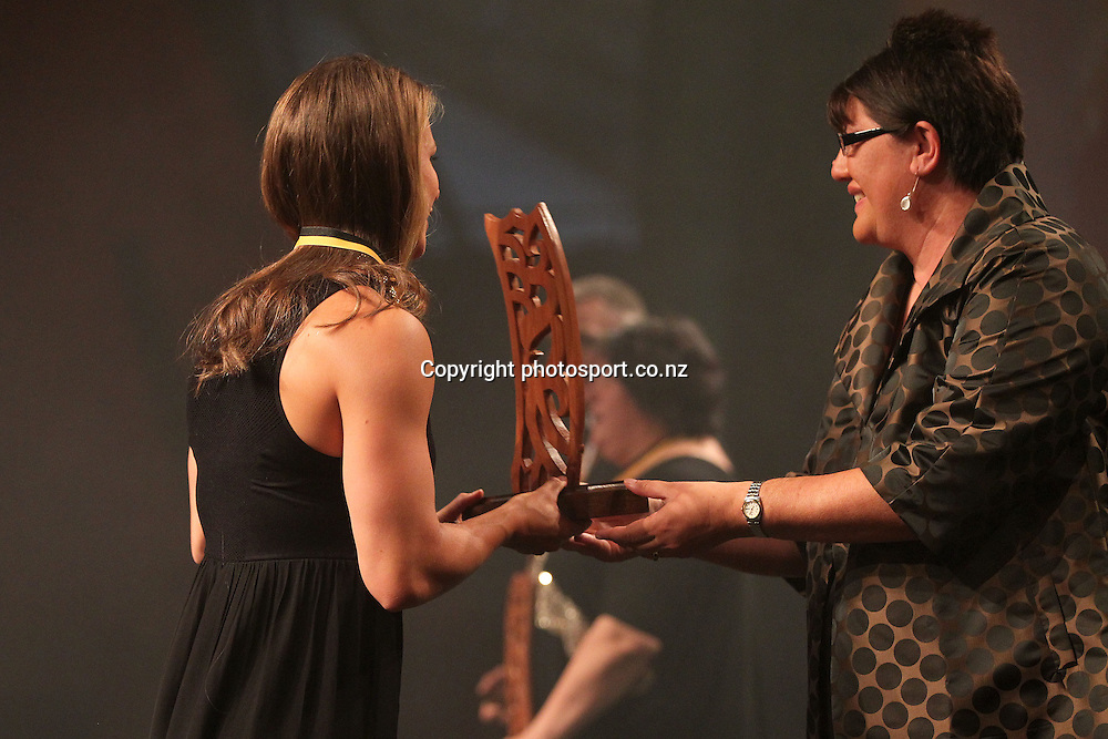 301113 2013  Michelle Hippolite, right presents the individual Maori world champion awards to Lisa Carrington for canoeing at the Trillian Trust Maori Sports Awards at Vodafone Events Centre, Manukau. Photo: Fiona Goodall/photosport.co.nz