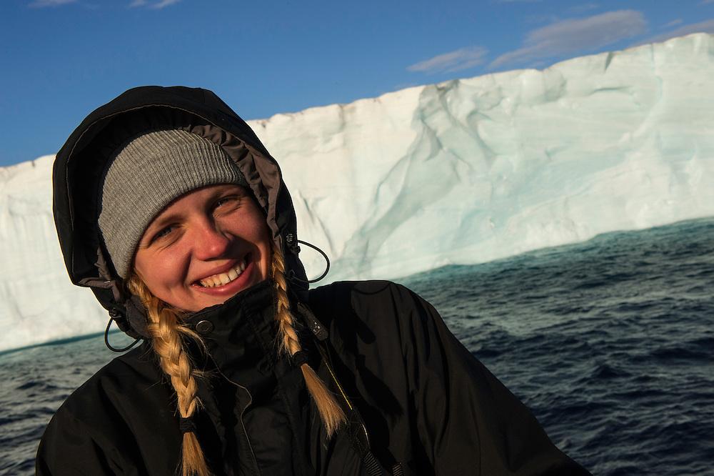 Polar traveller Liisa Widstrand in front of Austfonnabreen glacier front, Svalbard, Norway, Arctic