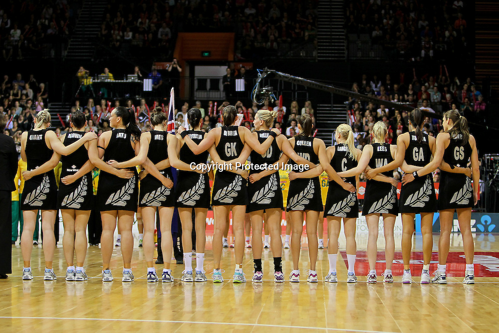 The Silver Ferns stand united during the Australian national anthem.  New World Quad Series - Silver Ferns v Australian Diamonds, 1 November 2012.  Photo:  Bruce Lim / www.photosport.co.nz