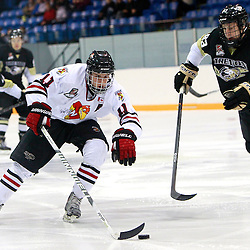 NEWMARKET, ON - Feb 20 : Ontario Junior Hockey League Game Action between the Trenton Golden Hawks and the Newmarket Hurricanes, Brandon Francisco #11 of the Newmarket Hurricanes Hockey Club skates with the puck during first period game action.<br /> (Photo by Brian Watts / OJHL Images)