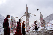 Buddhist monks play basketball on a court in their mountainside monastery in Zado, Tibet (Qinghai, China).