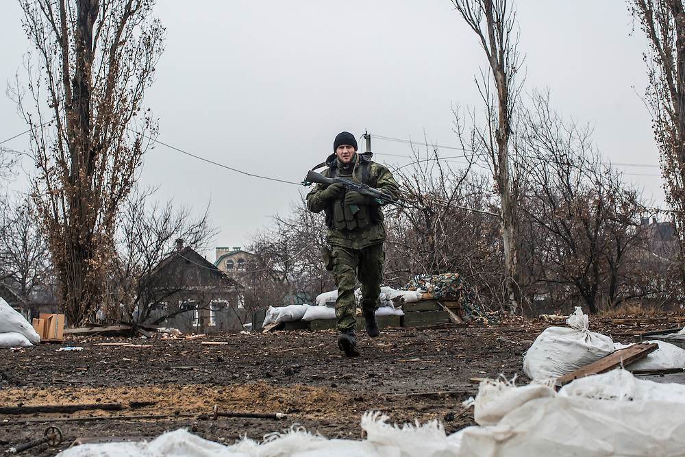 PIKSY, UKRAINE - NOVEMBER 19, 2014: Ivan, a member of the Dnipro-1 brigade, a pro-Ukraine militia, runs along the front lines in Pisky, Ukraine. The village of Pisky is the scene of much of the front-line fighting over the Donetsk airport. CREDIT: Brendan Hoffman for The New York Times
